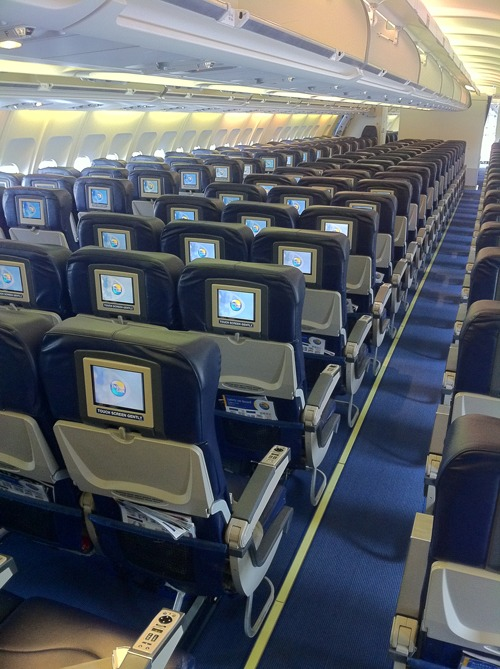 """""""Thomas Cook Airlines Airbus A330 Economy Class Cabin"""" by SempreVolando - Own work. Licensed under CC BY-SA 3.0 via Wikimedia Commons - https://commons.wikimedia.org/wiki/File:Thomas_Cook_Airlines_Airbus_A330_Economy_Class_Cabin.jpg#/media/File:Thomas_Cook_Airlines_Airbus_A330_Economy_Class_Cabin.jpg"""