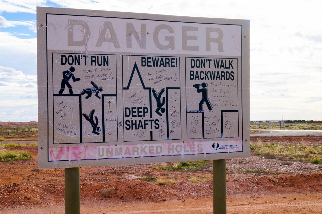 warning dangerous holes sign