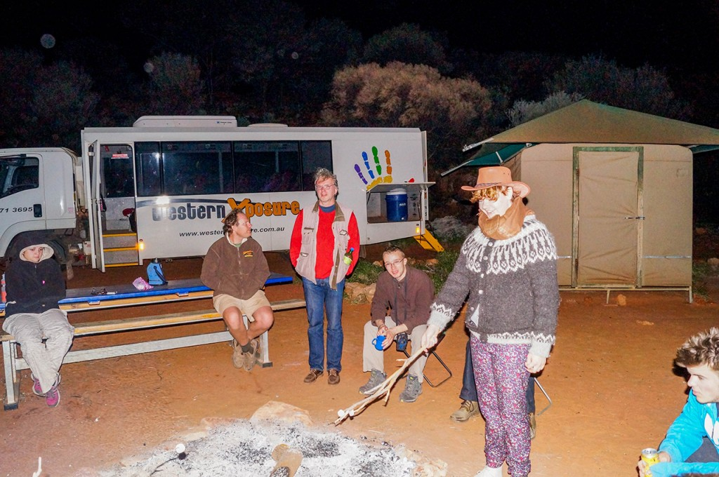 Tour Group Building a Campfire in Australia