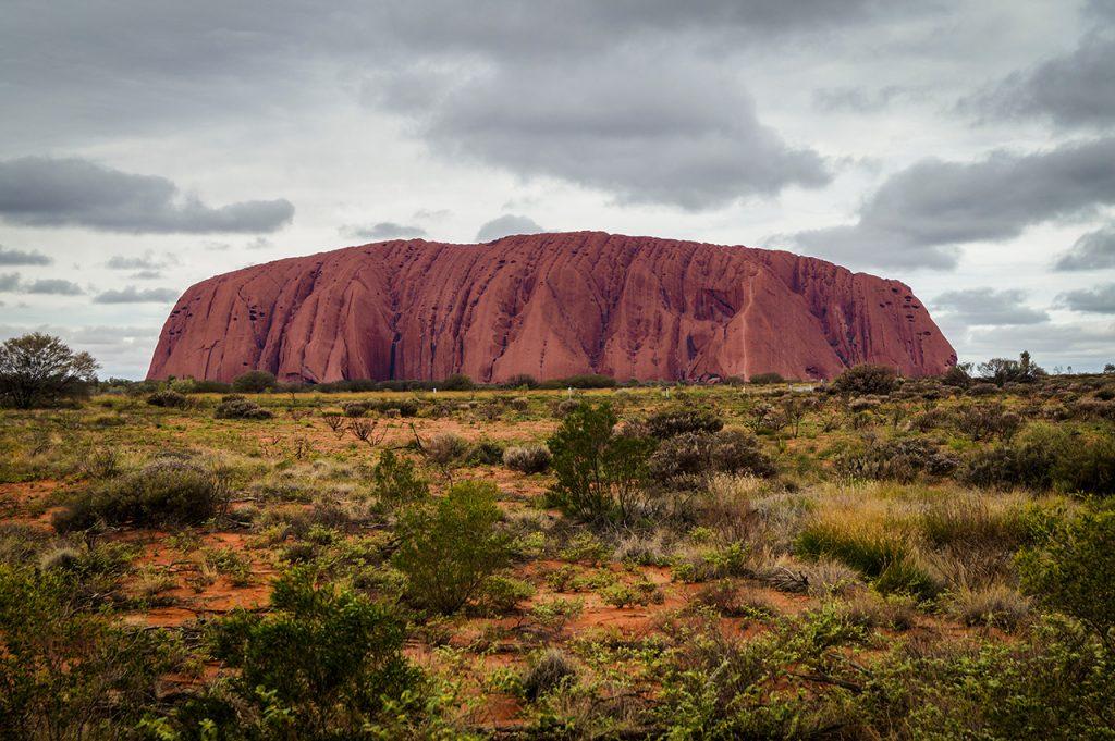 Uluru with rain and clouds
