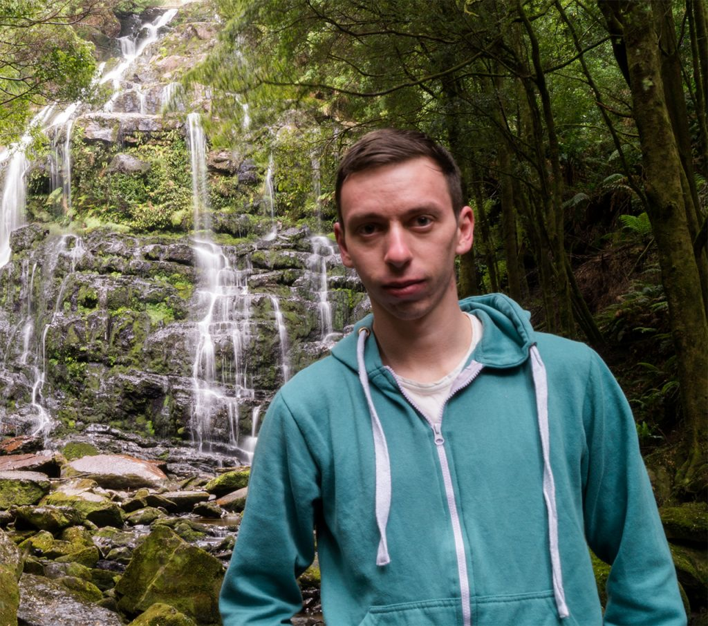 Marc at a waterfall in Tasmania
